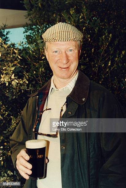 Ireland football manager and former footballer Jack Charlton with a pint of Guinness, 1994.