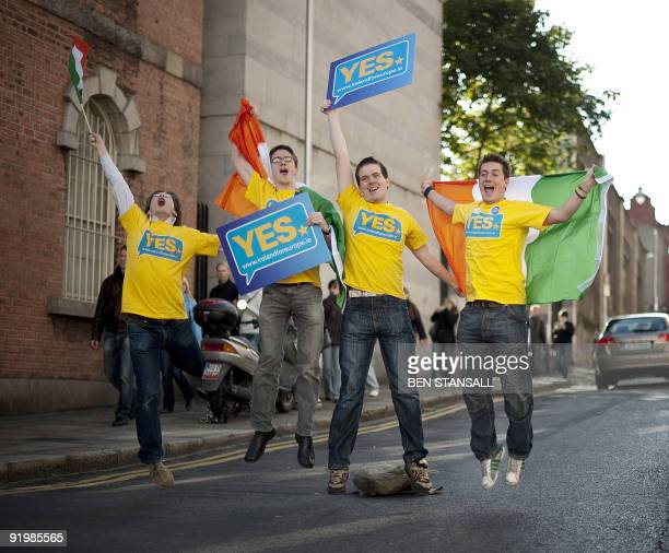 Ireland For Europe supporters celebrate at the gates of Dublin Castle following a majority vote in favour of the European Union's Lisbon Treaty in...