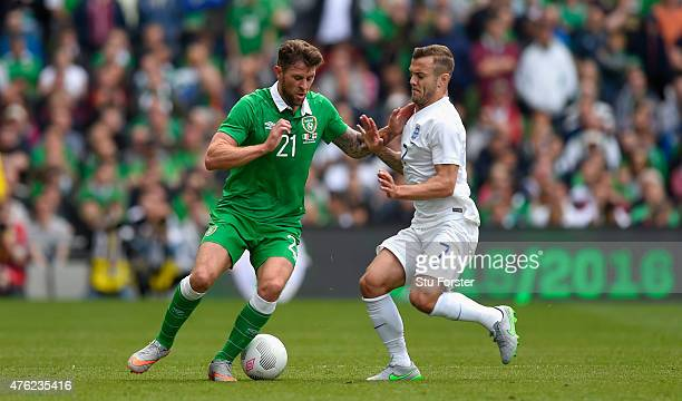 Ireland forward Daryl Murphy is challenged by Jack Wilshire during the International friendly match between Republic of Ireland and England at Aviva...