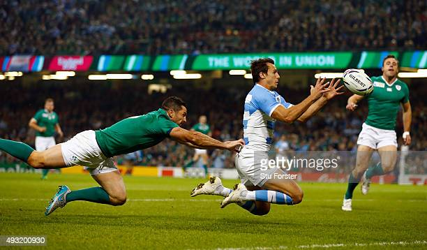 Ireland fullback Rob Kearney fails to stop Juan Imhoff of Aargentina scoring the second try during the 2015 Rugby World Cup Quarter Final match...