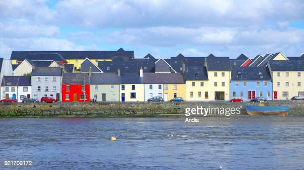 Ireland Galway Houses with colourful facades along Long Walk viewed from Claddagh Quay