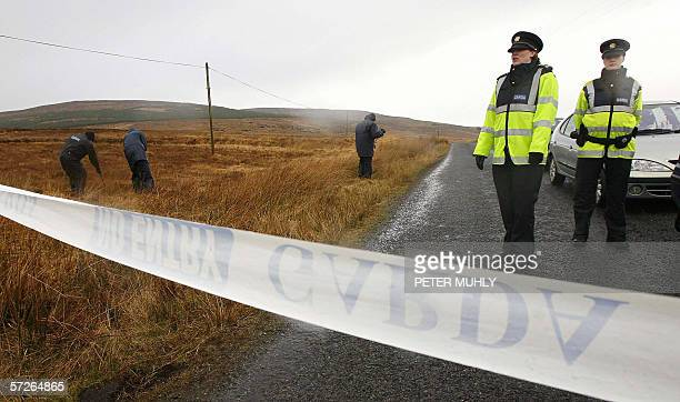 Garda police officers search the grounds around the home of a former IRA spy for the British government Denis Donaldson in Glentise Co Donegal in...