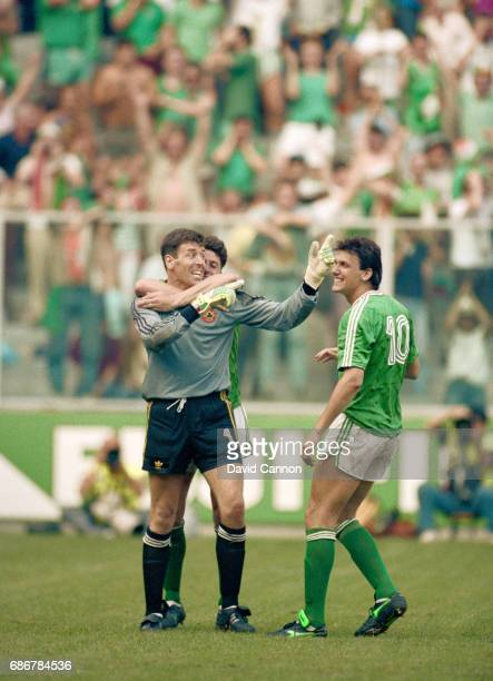 Ireland goalkeeper Pat Bonner is congratulated by Andy Townsend and Tony Cascarino after Bonner had saved the penalty from Romania player Daniel...