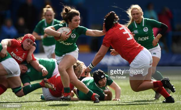Ireland hooker Deirbhile Nic A Bhaird hands off Amy Evans of Wales during the Wales Women v Ireland Women match in the Women's Six Nations at Cardiff...