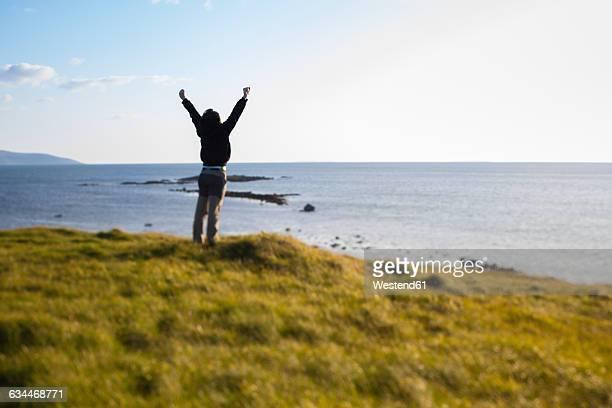 Ireland, Man enjoying the wind in Connemara