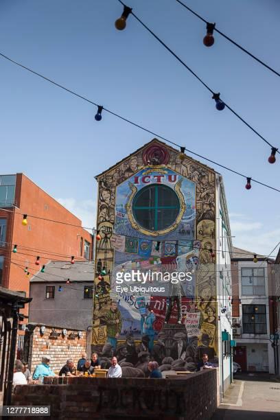 Ireland, North, Belfast, Cathedral Quarter, Colourfiul mural behind the John Hewitt pub.