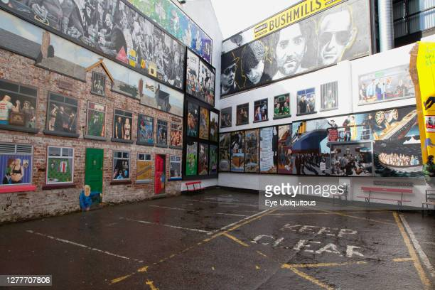 Ireland, North, Belfast, Cathedral Quarter, Decorated walls in Commercial Court.