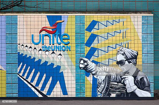 Ireland North Belfast Colourful mural depicting Unite Union workers on the exterior of the TGWU building on the corner of Donegall and High Street