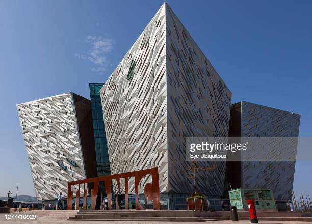Ireland, North, Belfast, Titanic Quarter, Visitor centre designed by Civic Arts & Eric R Kuhne, with statue of diving woman in foreground.