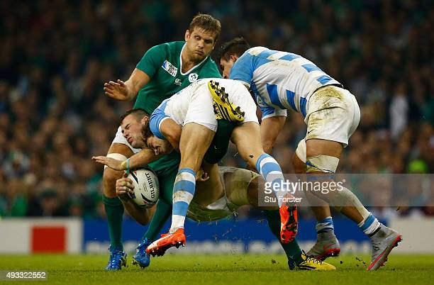 Ireland player Robbie Henshaw is tackled by Nicolas Sanchez during the 2015 Rugby World Cup Quarter Final match between Ireland and Argentina at...