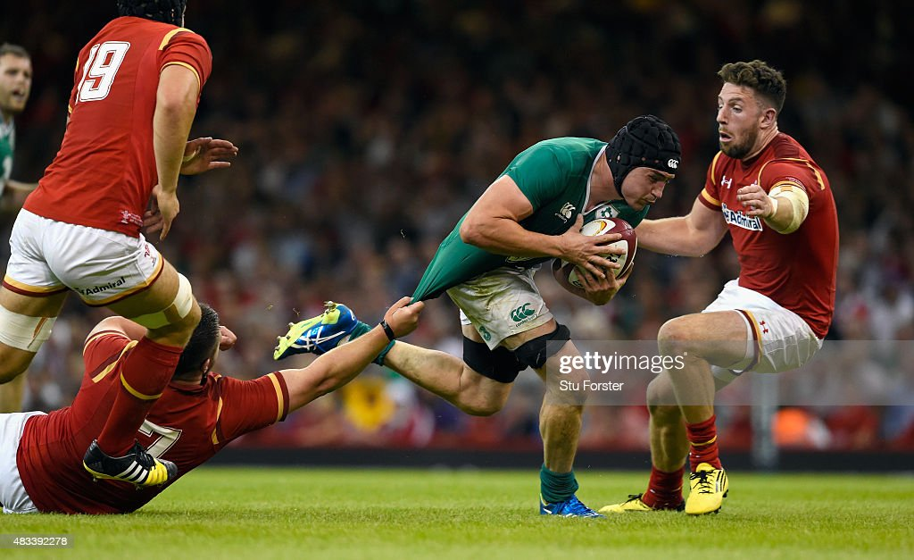 Ireland player Tommy O' Donnell skips a tackle before being grounded with an injury during the Rugby World Cup warm up match between Wales and Ireland at Millennium Stadium on August 8, 2015 in Cardiff, Wales.