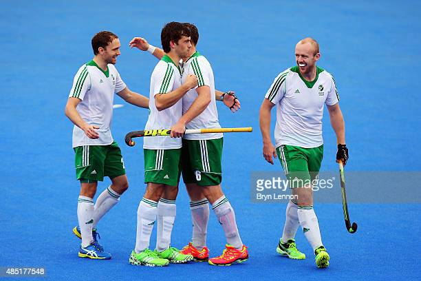 Ireland players celebrate progressing to the semifinals after drawing in their match with Belgium on day five of the Unibet EuroHockey Championships...