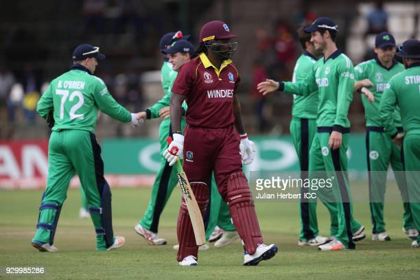 Ireland players celebrate the wicket of Chris Gayle of The West Indies during The ICC Cricket World Cup Qualifier between The West Indies and Ireland...