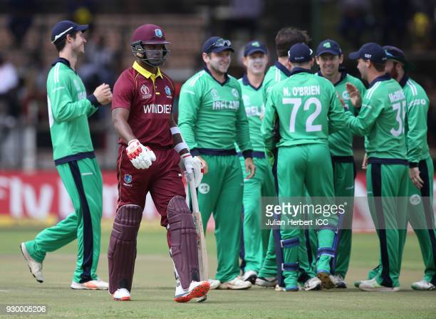 Ireland players celebrate the wicket of Marlon Samuels of The West Indies during The ICC Cricket World Cup Qualifier between The West Indies and...