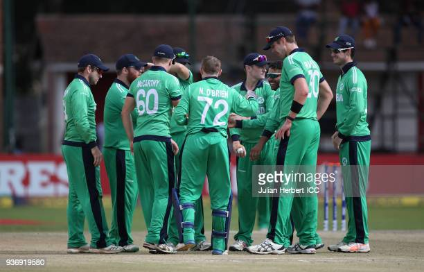 Ireland players celebrate the wicket of Rahmat Shah of Afghanistan during The ICC Cricket World Cup Qualifier between Ireland and Afghanistan at The...