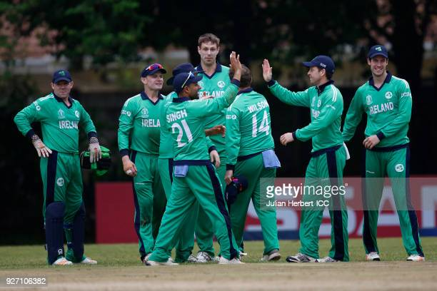 Ireland players celebrate the wicket of Roelf van der Merwe of The Netherlands during the ICC Cricket World Cup Qualifier between Ireland and The...