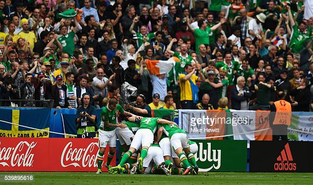 Ireland players celebrate their team's first goal during the UEFA EURO 2016 Group E match between Republic of Ireland and Sweden at Stade de France...