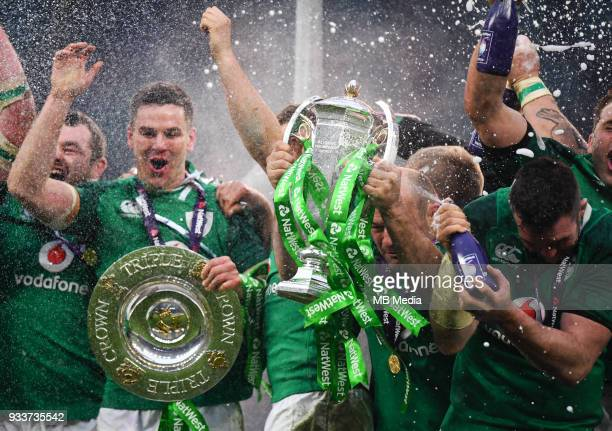 Ireland players celebrate with the Triple Crown Trophy after the NatWest Six Nations Championship match between England and Ireland at Twickenham...