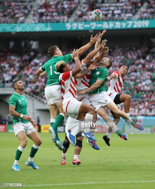 Ireland players Gary Ringrose and Jack Carty compete for a high ball during the Rugby World Cup 2019 Group A game between Japan and Ireland at...