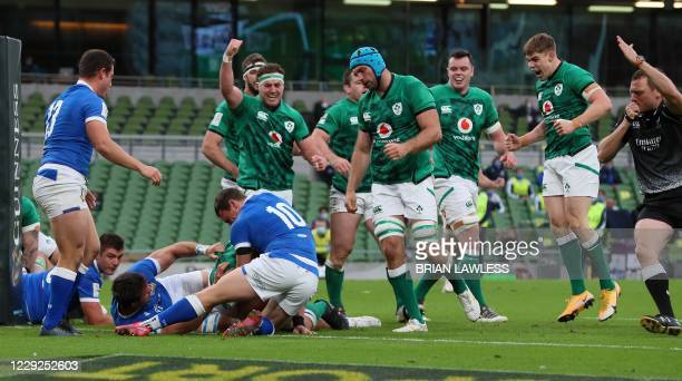Ireland players react as Ireland's number 8 Cj Stander scores his team's first try during the Six Nations international rugby union match between...