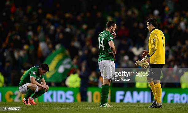 Ireland players Sean St Ledger Marc Wilson and goalkeeper David Forde look on dejectedly after the FIFA 2014 World Cup Group C Qualifiying match...