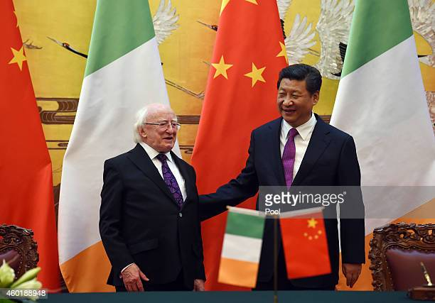 Ireland President Michael Higgins and Chinese President Xi Jinping wait for the start of a signing ceremony in Beijing's Great Hall of the People on...
