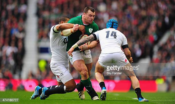 Ireland prop Cian Healy runs into England players Luther Burrell and Jack Nowell during the RBS Six Nations match between England and Ireland at...