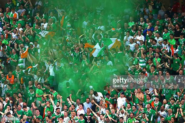 Ireland supporter light a flare to celebrate their team's first goal during the UEFA EURO 2016 Group E match between Italy and Republic of Ireland at...
