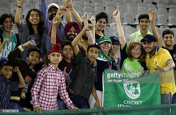 Ireland supporters pose with locals during the Women's ICC World Twenty20 India 2016 match between Sri Lanka and Ireland at the IS Bindra Stadium on...