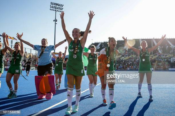 Ireland team celebrate with their silver medals after their field hockey final match between the Netherlands and Ireland at the 2018 Women's Hockey...