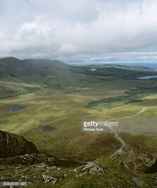 Ireland, Tralee, Ring of Kerry, country road in rolling landscape