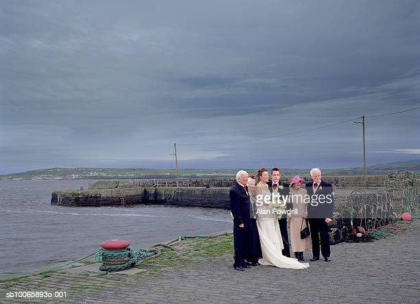 ireland, west cork, wedding party by sea - dinner jacket stock pictures, royalty-free photos & images
