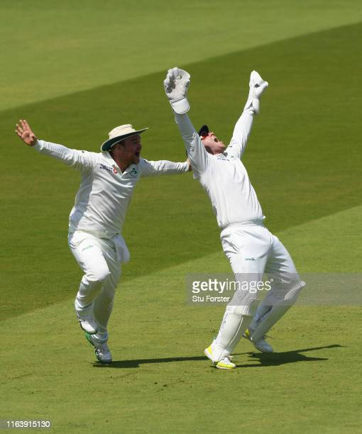 Ireland wicketkeeper Gary Wilson celebrates after catching out Moeen Ali to give Tim Murtagh his 5th wicket during day one of the Specsavers Test...