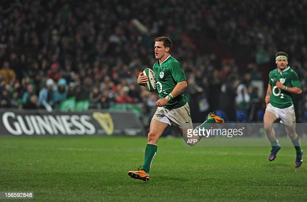 Ireland wing Craig Gilroy runs in his second try during the International rugby union match between an Ireland XV and Fiji at Thomond Park in...