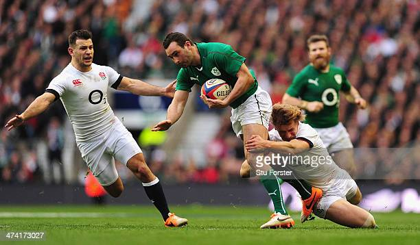 Ireland wing Dave Kearney is tackled by Billy Twelvetrees as Danny Care looks on during the RBS Six Nations match between England and Ireland at...