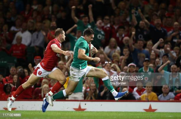 Ireland wing Jacob Stockdale outpaces Hallam Amos to score the second Ireland try during the International match between Wales and Ireland at...