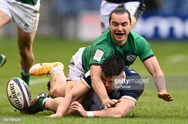 Ireland wing James Lowe and Scotland wing Sean Maitland compete for a loose ball during the Guinness Six Nations match between Scotland and Ireland...