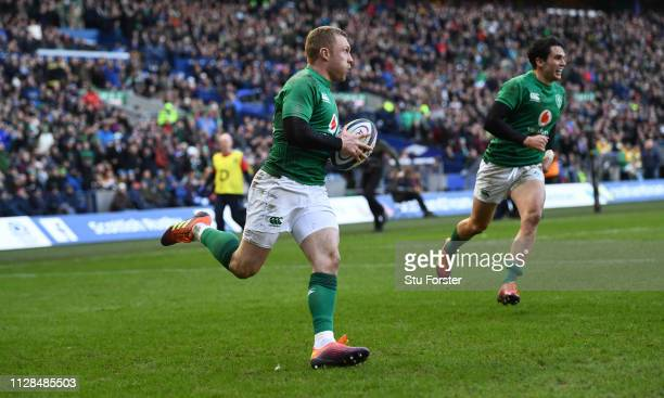 Ireland wing Keith Earls races over to score the 3rd Ireland try as Try architect Joey Carbery looks on during the Guinness Six Nations match between...