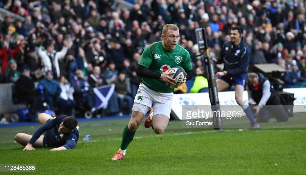 Ireland wing Keith Earls races over to score the 3rd Ireland try during the Guinness Six Nations match between Scotland and Ireland at Murrayfield on...