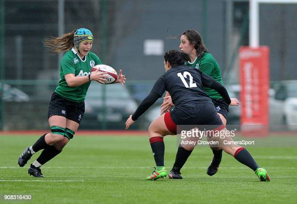 Ireland womens Anna Caplice evades the tackle of Wales womens Rebecca De Filippo during the Rugby Womens Friendly match between Wales Women and...