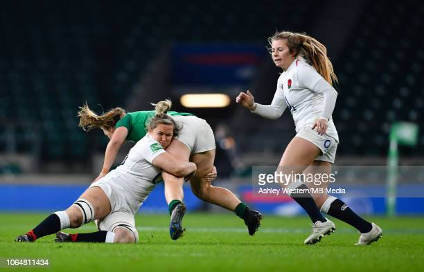 Ireland Women's Michelle Claffey is tackled by England Women's Marlie Packer during the Quilter International match between England Women and Ireland...
