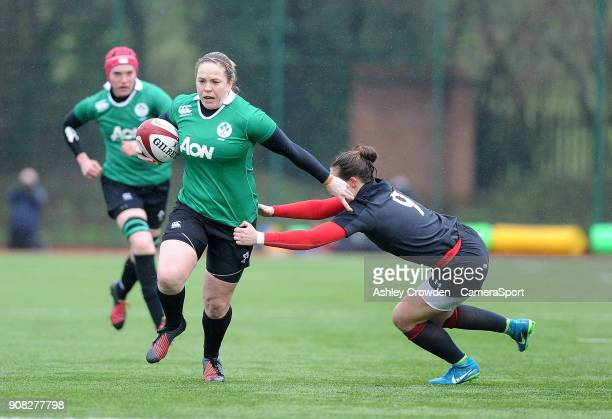 Ireland womens Niamh Briggs evades the tackle of Wales womens Jade Knight during the Rugby Womens Friendly match between Wales Women and Ireland...