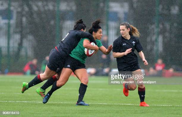 Ireland womens Sene Naoupu is tackled by Wales womens Rebecca De Filippo during the Rugby Womens Friendly match between Wales Women and Ireland Women...