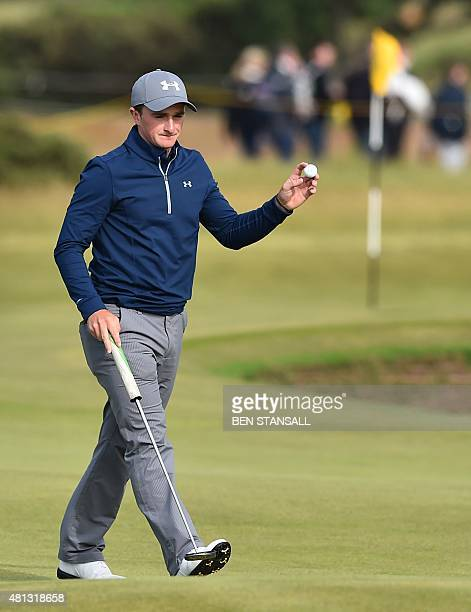 Ireland's amateur golfer Paul Dunne acknowledges the crowd after making a par on the 14th green during his third round 66, on day four of the 2015...