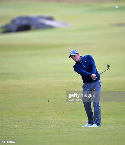 Ireland's amateur golfer Paul Dunne chips onto the 18th green during his third round 66, on day four of the 2015 British Open Golf Championship on...