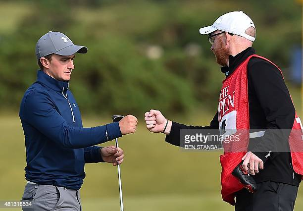 Ireland's amateur golfer Paul Dunne fist bumps his caddie Alan Murray on the 14th green during his third round 66, on day four of the 2015 British...