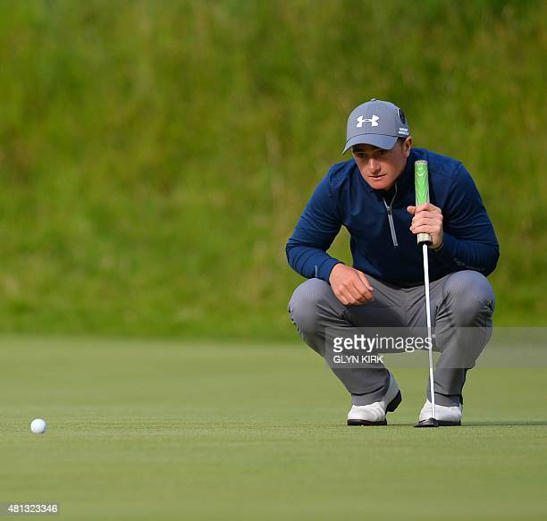 Ireland's amateur golfer Paul Dunne lines up his putt on the 18th green during his third round 66, on day four of the 2015 British Open Golf...