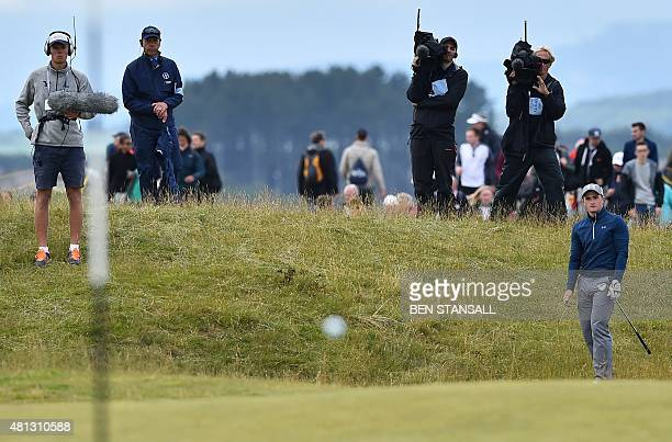 Ireland's amateur golfer Paul Dunne looks onto the 12th green during his third round, on day four of the 2015 British Open Golf Championship on The...