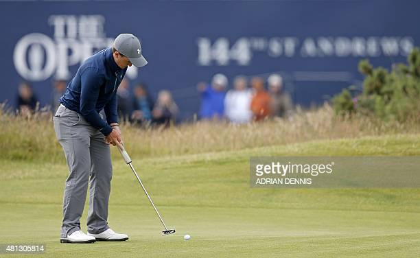 Ireland's amateur golfer Paul Dunne makes a birdie putt on the 1st green, on day four of the 2015 British Open Golf Championship on The Old Course at...