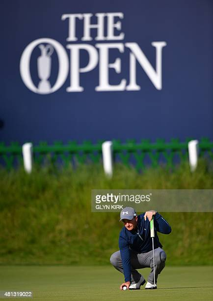 Ireland's amateur golfer Paul Dunne places his ball on the 18th green during his third round 66, on day four of the 2015 British Open Golf...